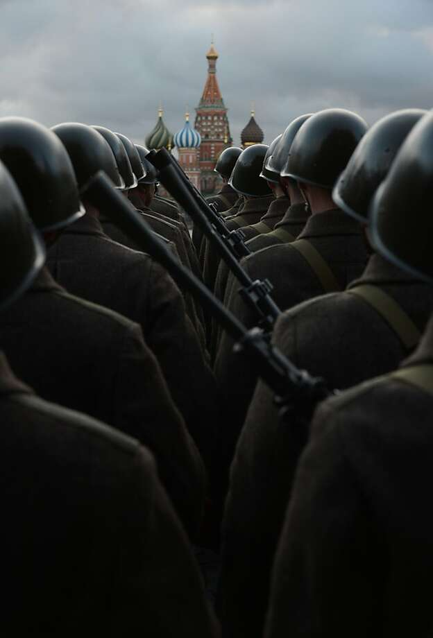 Defenders of the capital:Russian soldiers wearing the World War II-era uniform of Red Army troops parade on Moscow's Red Square. The event commemorated the 71st anniversary of the 1941 parade when Red Army soldiers marched to the front line from Red Square as Nazi German troops approached the outskirts of the city. Photo: Natalia Kolesnikova, AFP/Getty Images