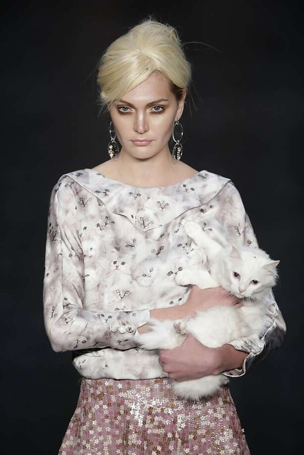Put ... me ... down: Dogs maybe, but a carrying a cat on the catwalk is just asking for trouble. (Oh Boy winter collection at Fashion Rio.) Photo: Felipe Dana, Associated Press