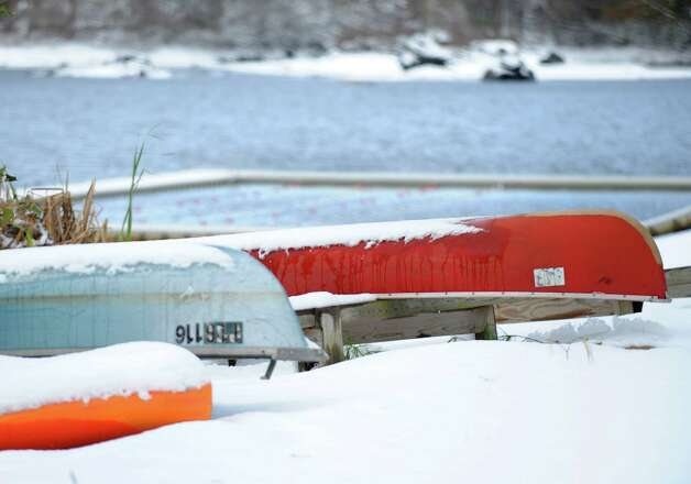 Boats sit in the snow along the banks of Samp Mortar Reservoir in Fairfield, Conn. on Thursday, Nov. 8, 2012. Photo: Cathy Zuraw / Connecticut Post