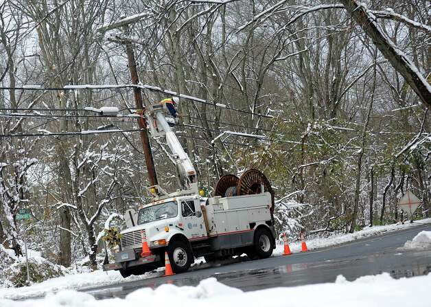 An AT&T lineman works on a pole at the cormer of Burr St. and Brookside Dr. in Fairfield, Conn. on Thursday, Nov. 8, 2012. Photo: Cathy Zuraw / Connecticut Post