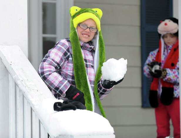 Bailey and Abby Schumacher make snowballs from their porch on Mill Plain Rd. in Fairfield, Conn. on Thursday, Nov. 8, 2012. Photo: Cathy Zuraw / Connecticut Post