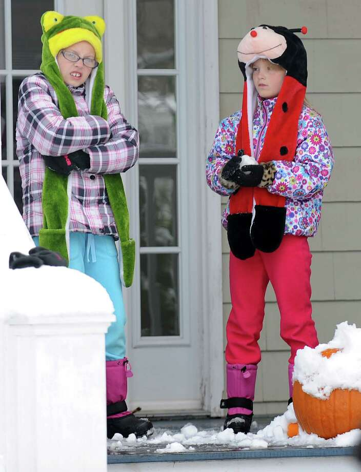 Bailey and Abby Schumacher on their porch on Mill Plain Rd. in Fairfield, Conn. as they wait to head to school on Thursday, Nov. 8, 2012. Photo: Cathy Zuraw / Connecticut Post
