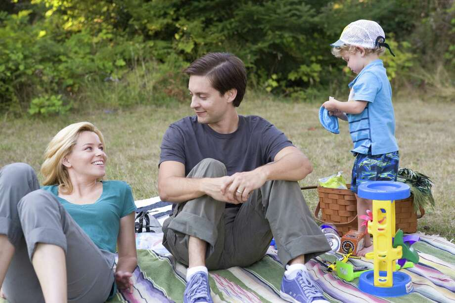 "This film image released by Radius/The Weinstein Company shows Elizabeth Banks, left, and Tobey Maguire in a scene from, ""The Details."" (AP Photo/Radius/The Weinstein Company, Jan Cook) Photo: Jan Cook / Radius/The Weinstein Company"
