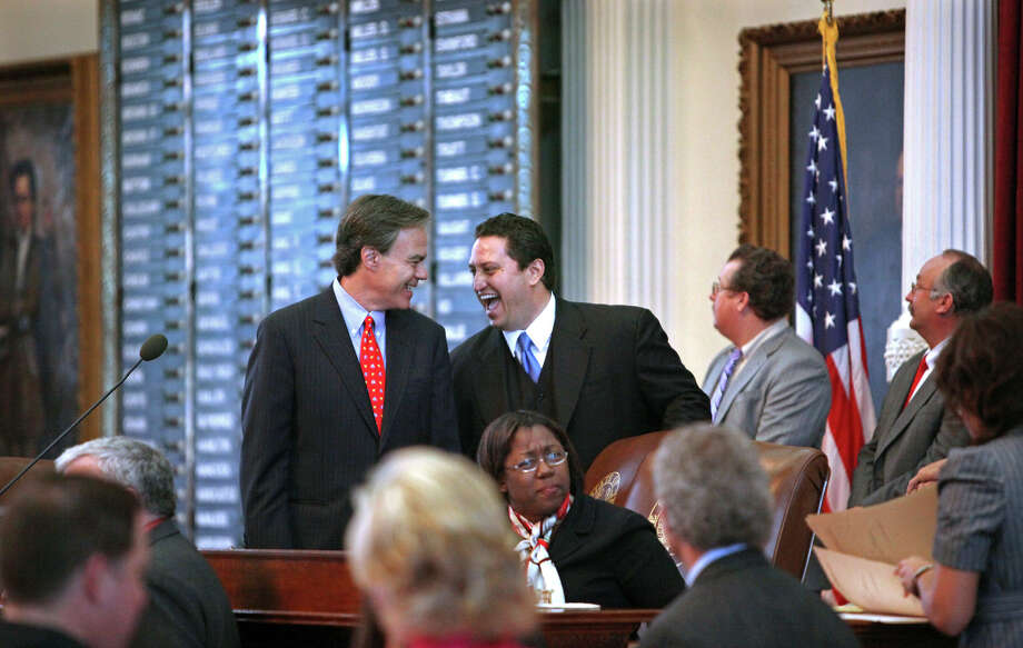 Trey Martinez Fischer, D-San Antonio, enjoys a conversation with House Speaker Joe Straus, R- San Antonio, on the Texas House floor. Texas lawmakers convene today for another 140-day session. Photo: File Photo, San Antonio Express-News / treel@express-news.net