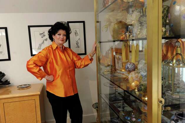 Kathe Birnbaum, an artist and decorator, shows her home in Greenwich Wednesday, Oct. 17, 2012. Birnbaum stands with objects that she found at the Greenwich Hospital Auxilary Thrift Shop. Photo: Helen Neafsey / Greenwich Time