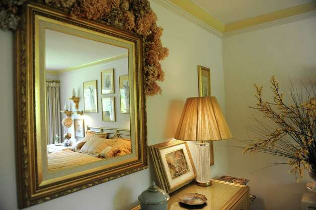Kathe Birnbaum, an artist and decorator, shows her home in Greenwich Wednesday, Oct. 17, 2012. A bedroom in Birnbaum's home. Photo: Helen Neafsey / Greenwich Time