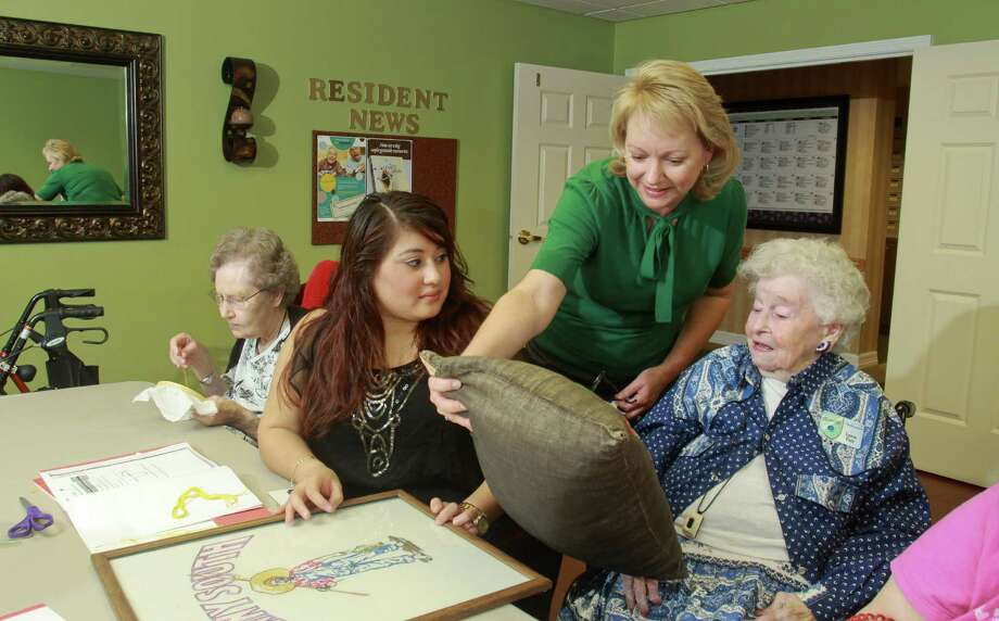 (For the Chronicle/Gary Fountain, September 21, 2012)  Resident Paula Tideman, from left, program specialist Sindy Mejia, executive director Kim Parnell, and resident Lynn Fair in an embroidery class at Atria Westchase, a retirement/assisted living facility.  (NOTE: SINDY IS SPELLED CORRECTLY.) Photo: Gary Fountain, Freelance / Copyright 2012 Gary Fountain.