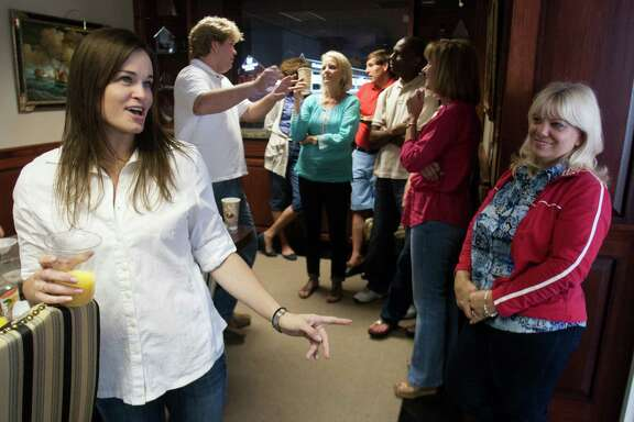 Christian Brothers Automotive employee Katie Rohr (left) enjoys a breakfast with coworkers on Friday, Sept. 21, 2012, in Houston.  The departments take turns bringing breakfast for the whole staff on Friday mornings. ( J. Patric Schneider / for the Chronicle )