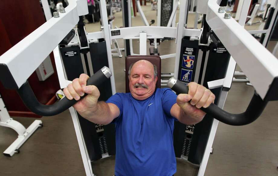 John Johnson, an engineer for Black Elk Energy, does his exercises at Life Time Athletic Club. Photo: James Nielsen, Staff / © Houston Chronicle 2012