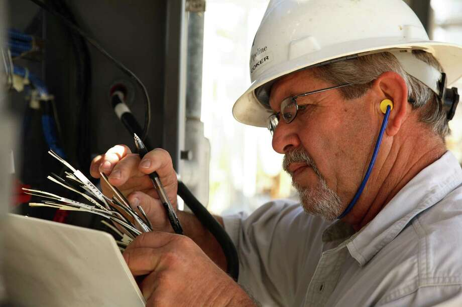 Gary Coker, a SCADA ((Supervisory Control and Data Acquisition) technician with Hilcorp, is preparing for a new SCADA system at the Old Ocean Plant in Sweeny, Texas. Coker has eight years of service. Hilcorp was named a Top Workplace in Houston. Photo: Hilcorp / Hilcorp