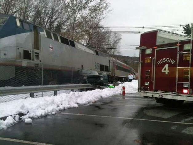 The driver of a SUV was injured after it was struck by a train near the Beacon Falls, Conn. train station on Thursday, Nov. 8, 2012, Metro-North officials said. Photo: WTNH News 8