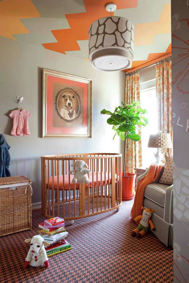 This undated photo provided by Brian Patrick Flynn and Hgtv.com shows an autumnal nursery designed by Brian Patrick Flynn with ceramic animal hooks for infant clothing in the Brooklyn borough of New York. The hooks add storage space and decorative flair, while making sure favorite outfits get used before the baby grows out of them. (AP Photo/Brian Patrick Flynn, Hgtv.com, Sarah Dorio) Photo: Sarah Dorio