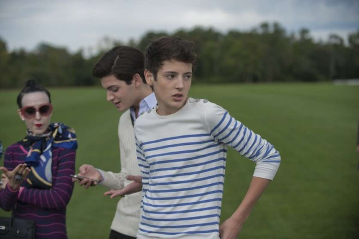 From left, Michelle Harper, Peter Brant II and Harry Brant at the Greenwich Polo Club at Conyers Farm in September 2011.