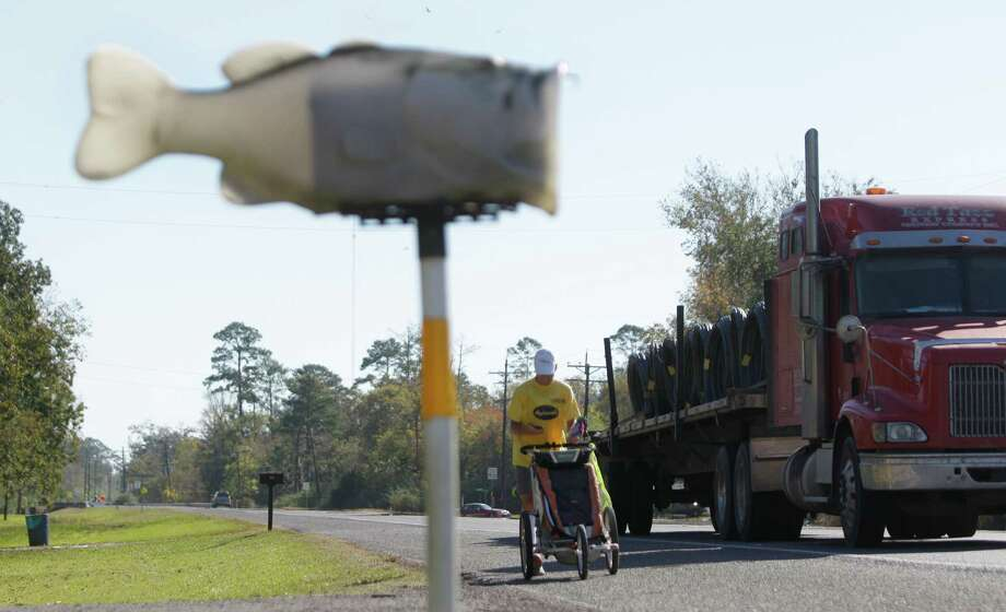 A fish themed mailbox sits along US 90 east of Liberty as Army veteran Mike Ehredt of Idaho runs as part of Project America Run Part II  Thursday, Nov. 8, 2012. He started in International Falls, MN at the Canadian border and will finish in Galveston on Veteran's Day. Photo: Melissa Phillip, Houston Chronicle / © 2012 Houston Chronicle