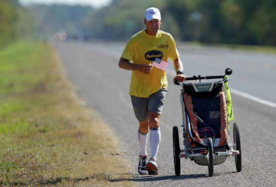 Army veteran Mike Ehredt of Idaho runs along US 90 east of Liberty as part of Project America Run Part II  Thursday, Nov. 8, 2012. Photo: Melissa Phillip, Houston Chronicle / © 2012 Houston Chronicle