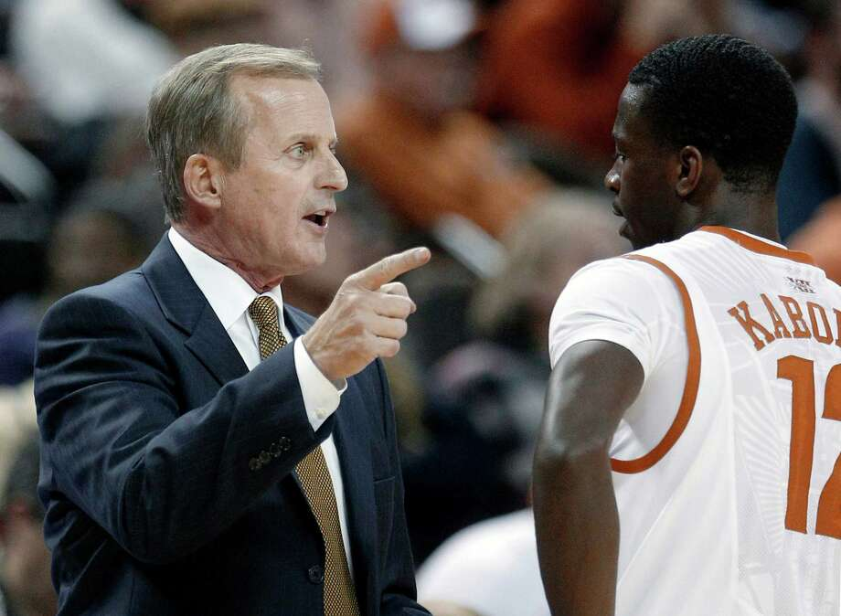In this Dec. 6, 2011, file photo, Texas coach Rick Barnes, left, talks with Myck Kabongo, right, during an NCAA college basketball game against Texas-Arlington in Austin, Texas. Kabongo is under investigation by the NCAA, which has raised questions about his relationship with Rich Paul, the agent of Miami Heat star LeBron James. The 2012-2013 season starts Nov. 9 against Fresno State. While Kabongo hasn't been declared ineligible and is still allowed to practice with the team, the Longhorns must brace for the possibility that he might not play. (AP Photo/Eric Gay, File) Photo: Eric Gay, Associated Press / AP