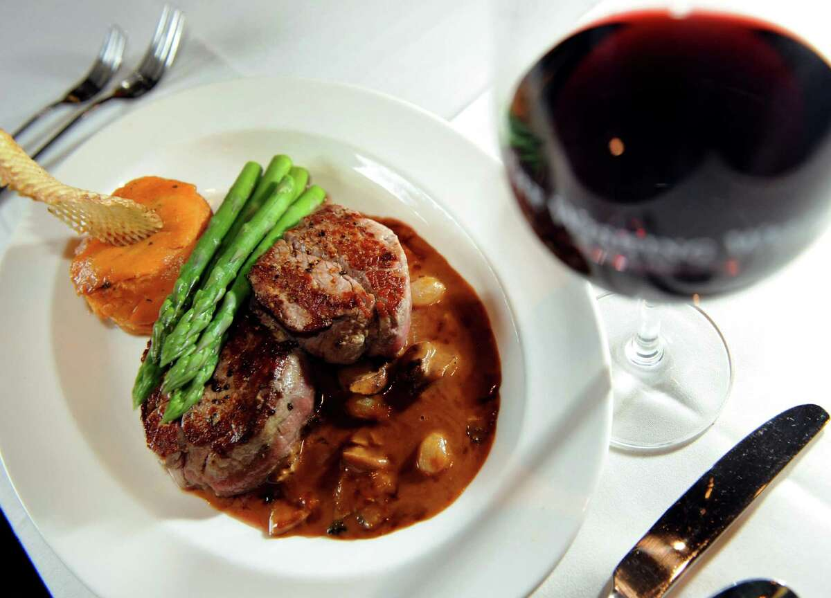 Steak Diane with a sweet potato cake, asparagus and a glass of red wine on Friday, Nov. 2, 2012, at the Wishing Well in Wilton, N.Y. (Cindy Schultz / Times Union)