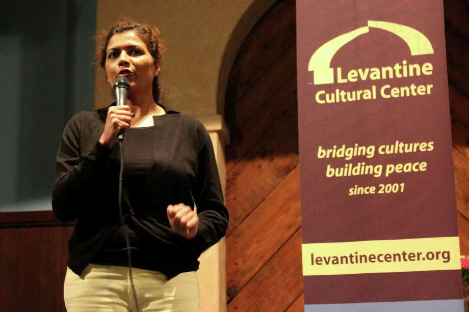 Mona Shaikh performs during the Sultans of Satire stand-up comedy show, which aims to challenge stereotypes and sensitivities about Muslims and Arabs while bringing people together through a few laughs -- even though much of the material couldn't be printed by a family-friendly newspaper. Photo: RNS Photo By Megan Sweas