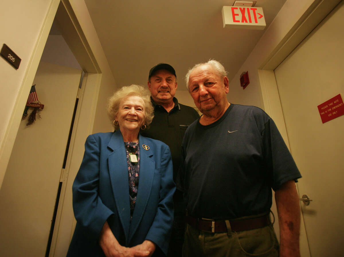 From left; Jeanette Marsella, Gaby Deeb, and Tony Dinzeo, residents at Bishop Curtis Homes at 1677 Post Road in Fairfield, received assistance from the Fairfield Fire Department when they lost emergency lighting during Hurricane Sandy.