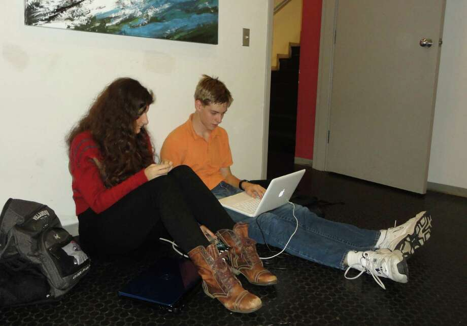 In the aftermath of Sandy, public libraries had more people looking for wireless Internet access than they did chairs. Photo: Meg Barone / Westport News freelance