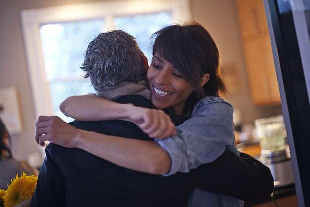 Dominique Crenn, Chef and owner of Atelier Crenn, hugs her friend who just came back from Germany where she had an exhibition. San Francisco, Calif. on Monday, Aug 20, 2012. Photo: Sonja Och, The Chronicle