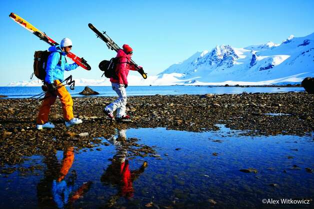Aurelien Ducroz and Jackie Paaso carry their skis in Svalbard, Norway. (Flow State / Alex Witkowicz)
