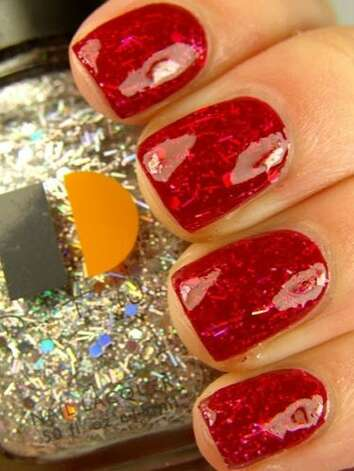"Disco ball Apply one coat of China Glaze ""Phat Santa,"" followed by a coat of Dare to Wear ""Disco Ball"" once it's dry. Finish with another coat of China Glaze ""Phat Santa"" and a top coat. Manicure courtesy of Stef at Steffels.