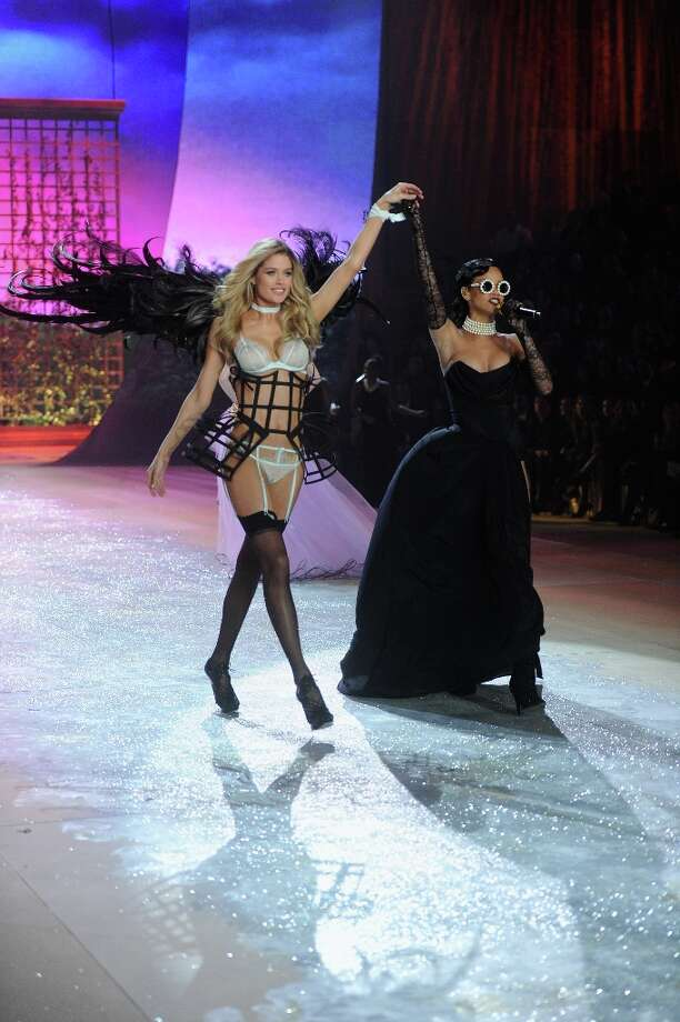 Victoria's Secret Angel Doutzen Kroes and singer Rihanna onstage during the 2012 Victoria's Secret Fashion Show at the Lexington Avenue Armory on November 7, 2012 in New York City.  (Photo by Jamie McCarthy/Getty Images) Photo: Jamie McCarthy, Getty Images / 2012 Getty Images