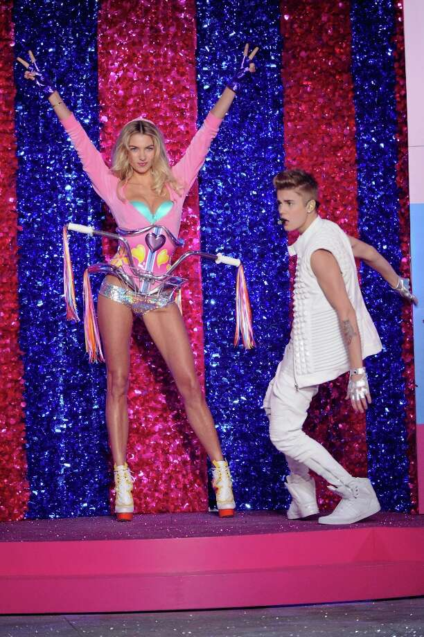 Singer Justin Bieber and model Jessica Hart onstage during the 2012 Victoria's Secret Fashion Show at the Lexington Avenue Armory on November 7, 2012 in New York City.  (Photo by Jamie McCarthy/Getty Images) Photo: Jamie McCarthy, Getty Images / 2012 Getty Images