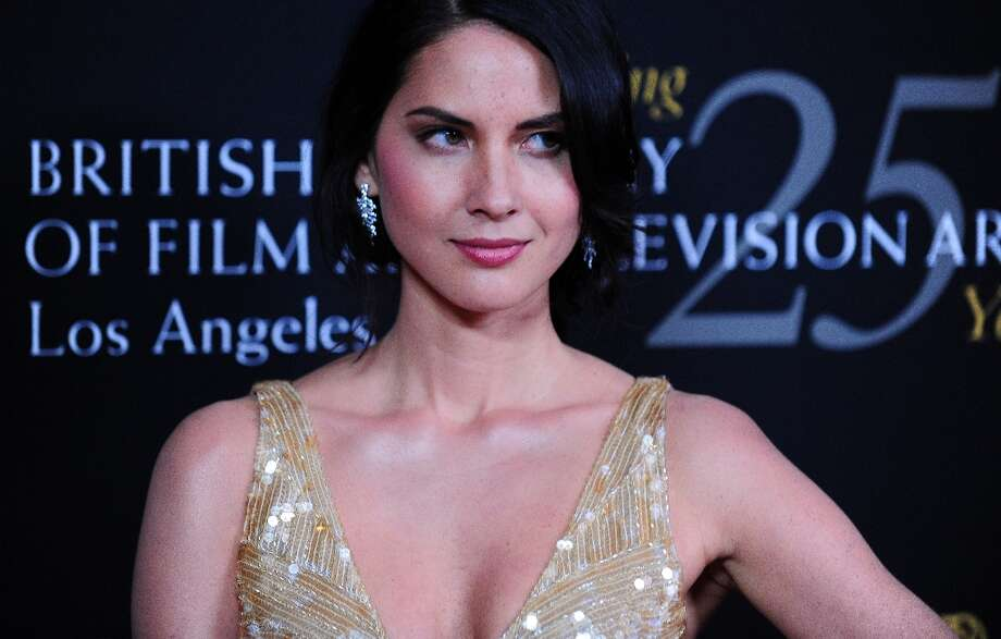 Actress Olivia Munn poses on arrival for BAFTA's 2012 Britannia Awards on November 7, 2012 in Beverly Hills, California. Photo: FREDERIC J. BROWN, AFP/Getty Images / AFP
