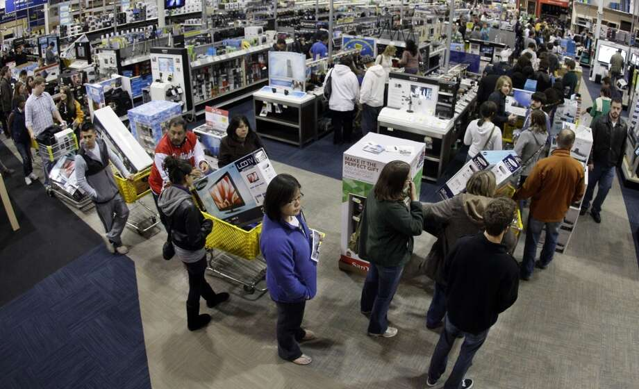 In this Friday, Nov. 25, 2011, file photo, a checkout line winds through a Best Buy store as shoppers take advantage of a midnight Black Friday sale on Friday, Nov. 25, 2011, in Brentwood, Tenn.  (Associated Press)