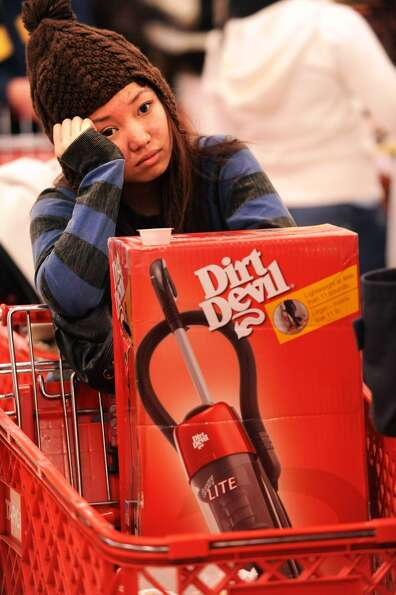 Black Friday shopper Susan Tu lines up to buy an iPod touch shortly after Target's 5 a.m. opening on