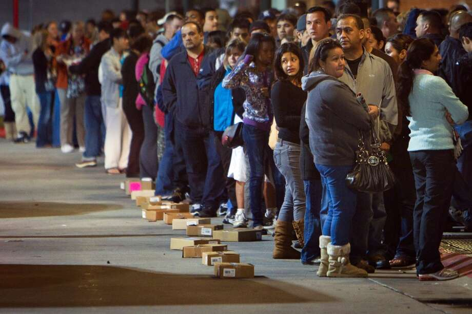 Shoppers hoping for Black Friday deals wait in a long line for the doors at the Target store on Sawyer Street near the downtown late on Thanksgiving night,  Thursday, Nov. 24, 2011, in Houston. (Smiley N. Pool / Houston Chronicle)