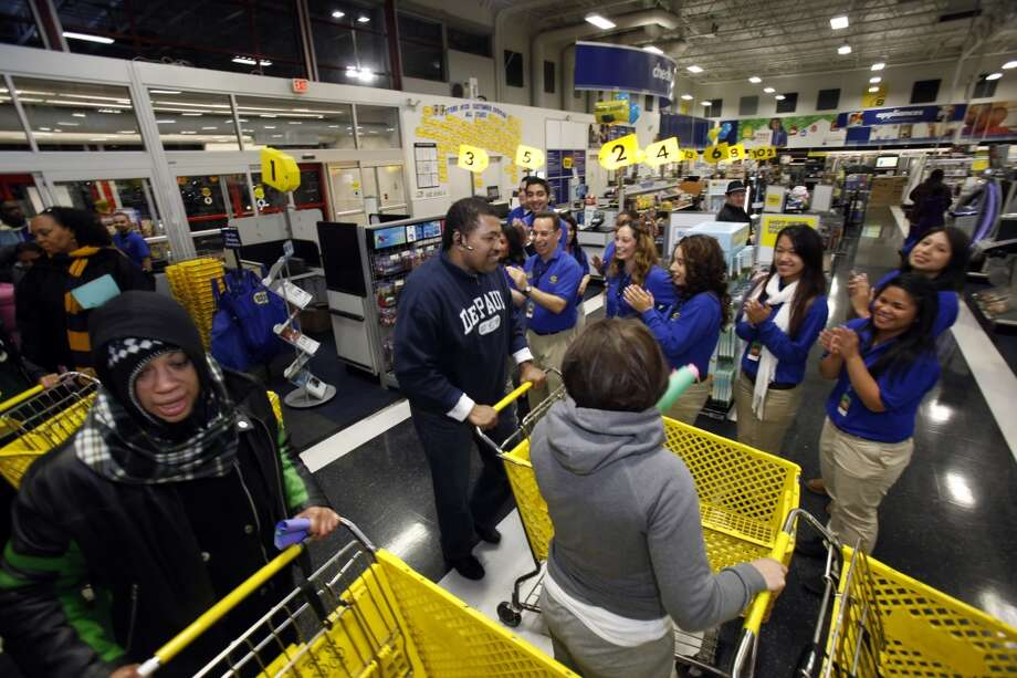 The first of the Black Friday shoppers are welcomed into the Best Buy store in Pinole on Friday, November 25, 2011. Hundreds of shoppers at Best Buy in Pinole, Calif., waited in line (some for days) for the beginning of the holiday shopping season at midnight following Thanksgiving. (Carlos Avila Gonzalez / The Chronicle)