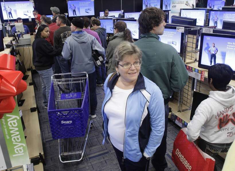 In this Nov. 25, 2011 photo, shoppers line up in the electronics department at a North Little Rock,