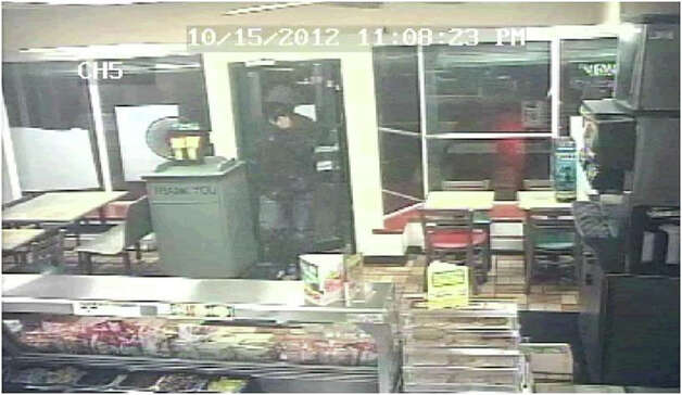 Police are looking to identify this man, who they say has robbed several gas stations in Bridgeport and Stratford. Photo: Contributed Photo