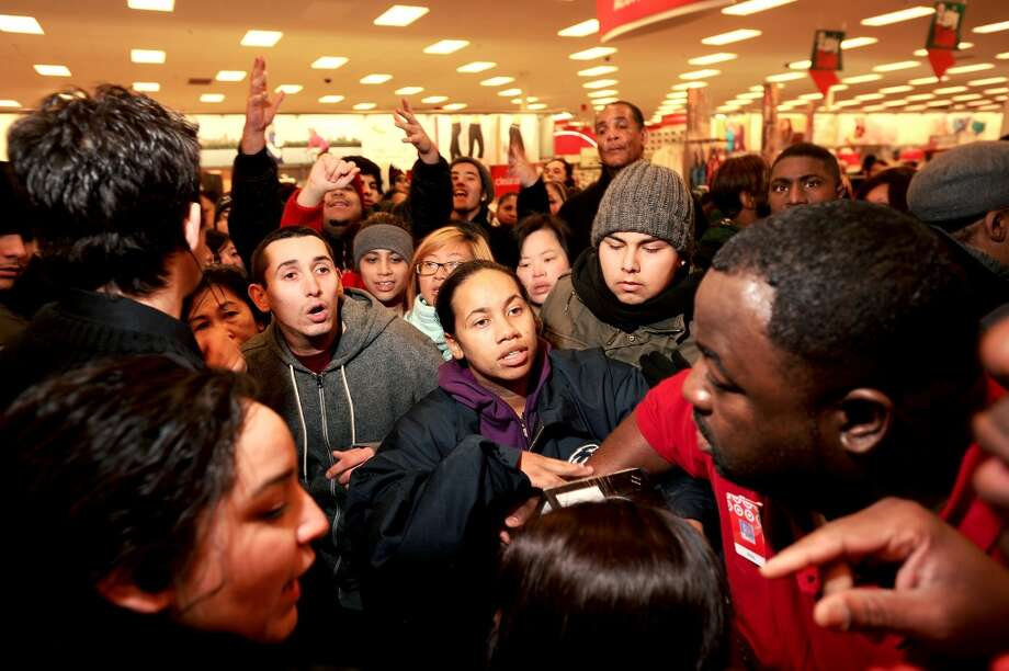 Black Friday shoppers clamor for the last discounted flat screen television at a San Leandro, Calif., Target store on Friday, Nov. 26, 2010. (Noah Berger / Special to The Chronicle)