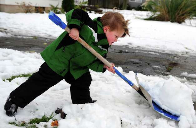 Three-year-old Kevin Macken helps his mother shovel Thursday, Nov. 8, 2012 at his home in Bridgeport, Conn. Photo: Autumn Driscoll / Connecticut Post