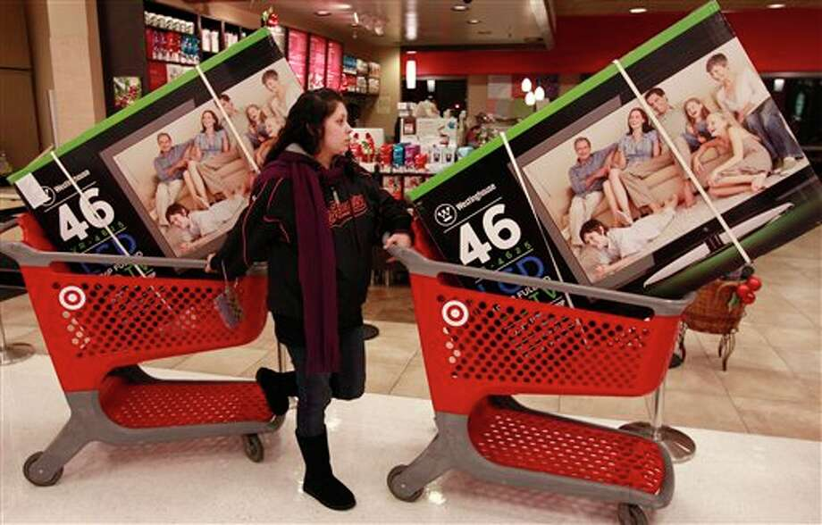 In this Nov. 25, 2011 file photo, Target customer Nancy, last name not given, guides her shopping carts with televisions purchased at a Target Store in Colma, Calif. Photo: Jeff Chiu, AP / AP