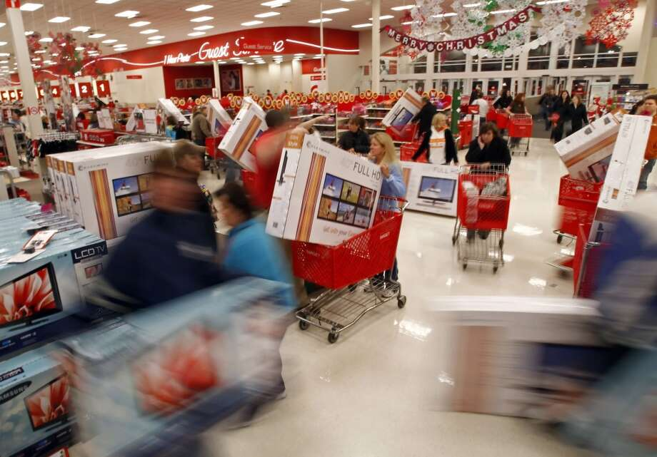 In this Friday, Nov. 25, 2011 file photo, shoppers grab televisions at a store in Knoxville, Tenn., minutes after it opened. (Associated Press)