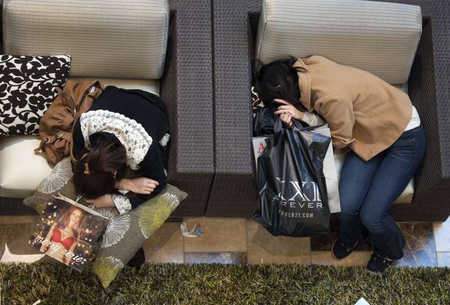 Black Friday shoppers take a rest at Westfield Galleria at Roseville in Sacramento, Calif., on Friday, Nov. 25, 2011. (Associated Press)