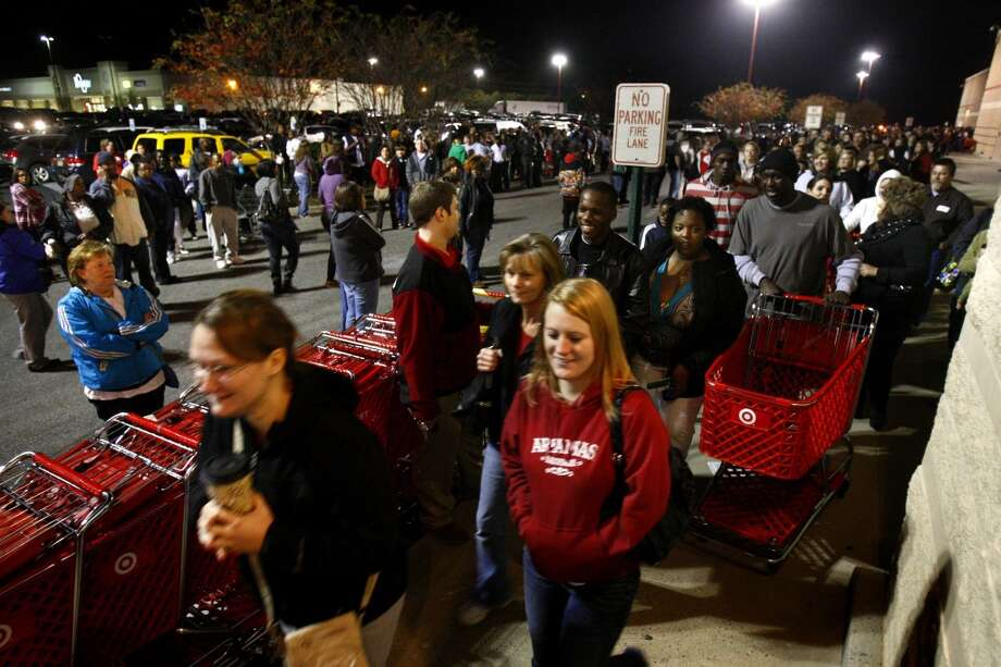 In this Friday, Nov. 25, 2011 file photo, customers, showing up early to stand in line, are allowed into Target in Horn Lake, Miss.  (Associated Press)