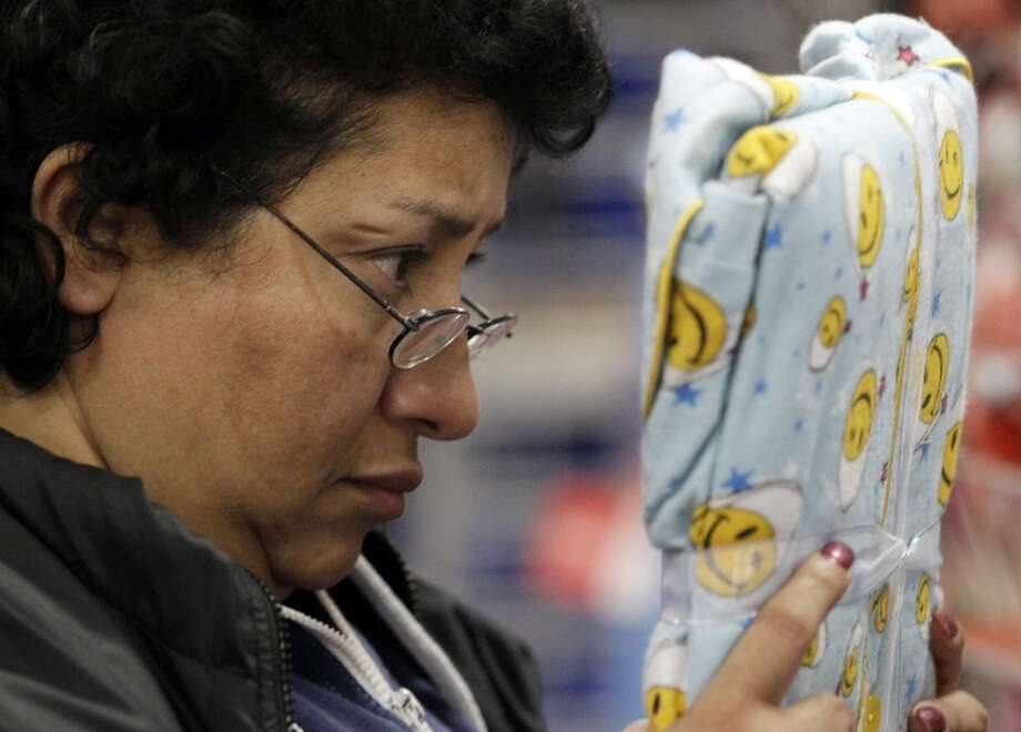 In this Nov. 24, 2011 file photo, Jasmin Garcia checks a sleeping wear price at a Kmart in Chicago.  (Associated Press)