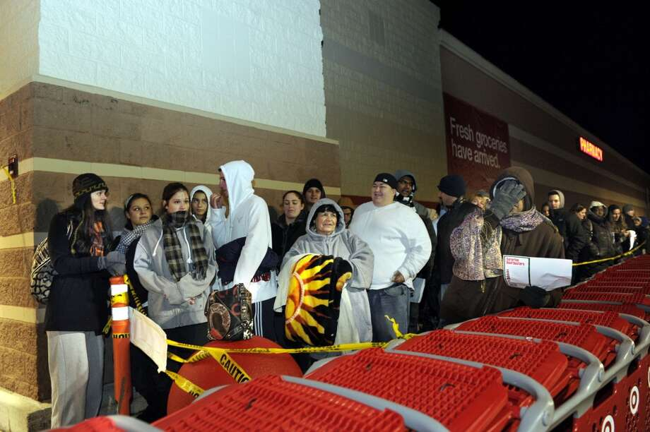Shoppers anticipating Black Friday sale prices line up at Target in Danbury, Conn., for the midnight opening of the store Thanksgiving night.Photo taken Thursday, Nov. 24, 2011. (Carol Kaliff)