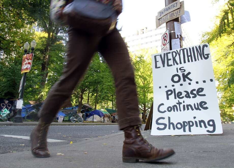 A joking sign is seen at one of several entrances to the Occupy Portland camp in Portland, Ore., Tuesday, Oct. 18, 2011. Occupy protesters wanted shoppers to occupy something besides door-buster sales and crowded aisles of big-box stores on Black Friday. (Associated Press)