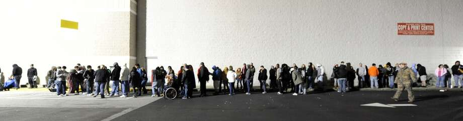 More than a thousand shoppers lined up outside Best Buy Thursday, Nov. 24, 2011, to take advantage of door buster deals on Black Friday in Bowling Green, Ky. Some shoppers spent 24 hours in line to be the first ones in the store. (AP)