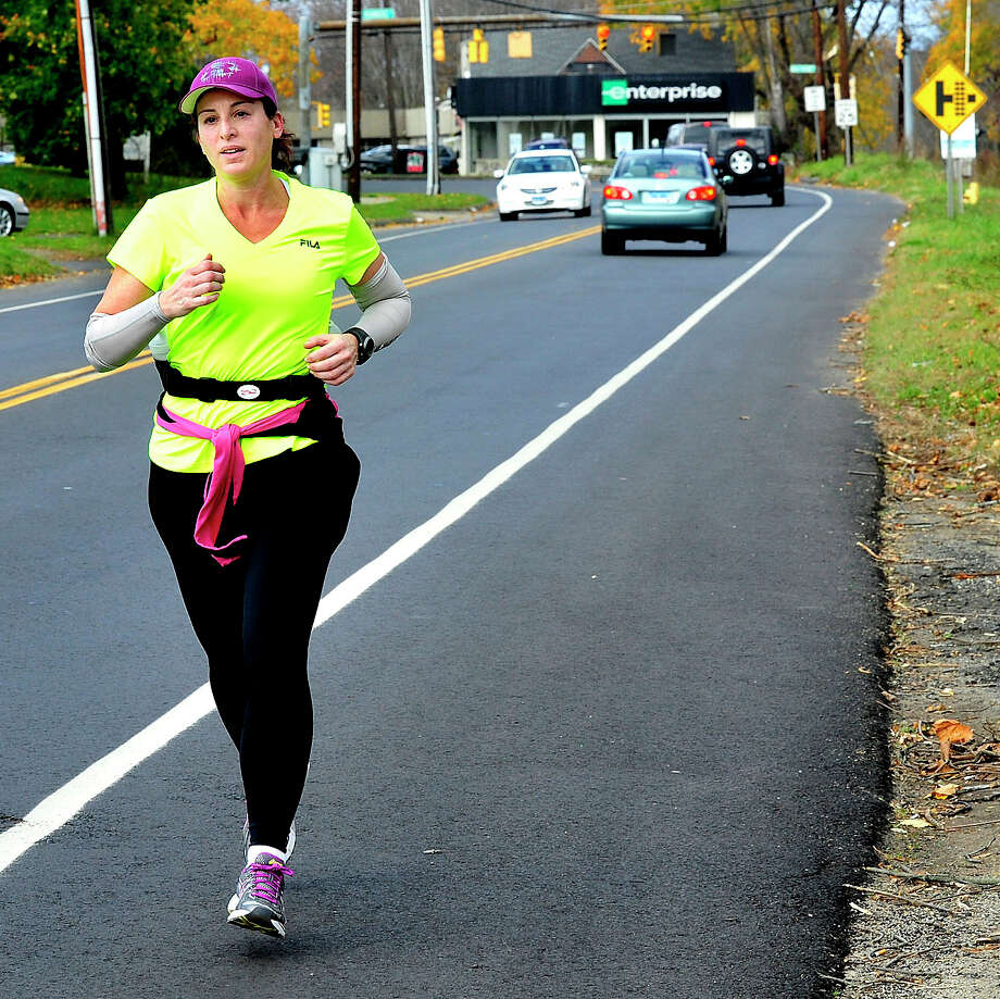 Carolyn Wolfe crosses the Danbury/Bethel border during a marathon-distance fundraising run Saturday, Nov. 3, 2012. Since the New York Marathon was canceled Wolfe is running locally to raise awareness of Hurricane Sandy victims. Photo: Michael Duffy / The News-Times