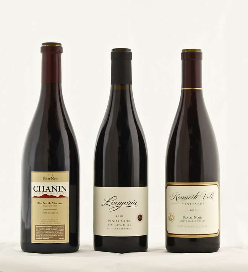 Left-right: 2010 Chanin Bien Nacido Vineyard Santa Maria Valley Pinot Noir; 2010 Longoria Fe Ciega Vineyard Sta. Rita Hills Pinot Noir; 2010 Kenneth Volk Vineyards Santa Maria Cuvee Santa Maria Valley Pinot Noir. Photo: Craig Lee, Special To The Chronicle