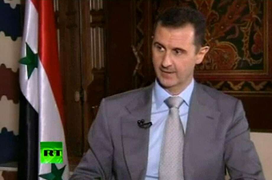 "Bashar Assad says the price of an invasion is ""more than the whole world can afford."" Photo: Associated Press"
