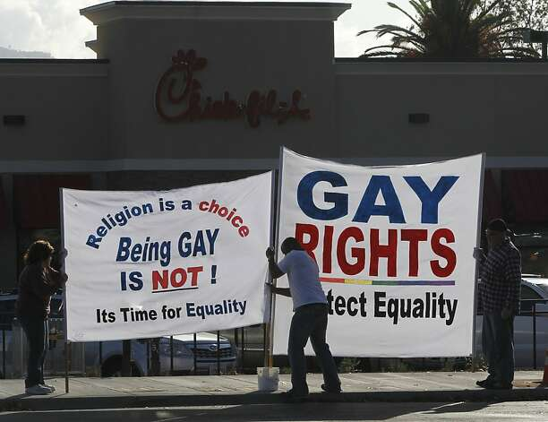 Protesters hang banners at the new Chick-fil-A in Walnut Creek because the firm's CEO opposes same-sex marriage. Photo: Paul Chinn, The Chronicle